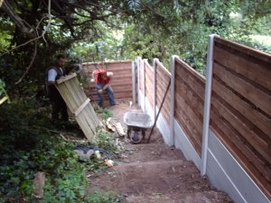 Installing heavy duty waney lap fence with concrete posts and gravel boards with 90 degree bend at bottom of the garden.