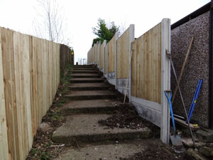 VCB fencing panel, with plain concrete bargeboards, during construction.