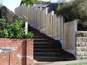 VCB fencing panel, with plain concrete bargeboards, finished installation.